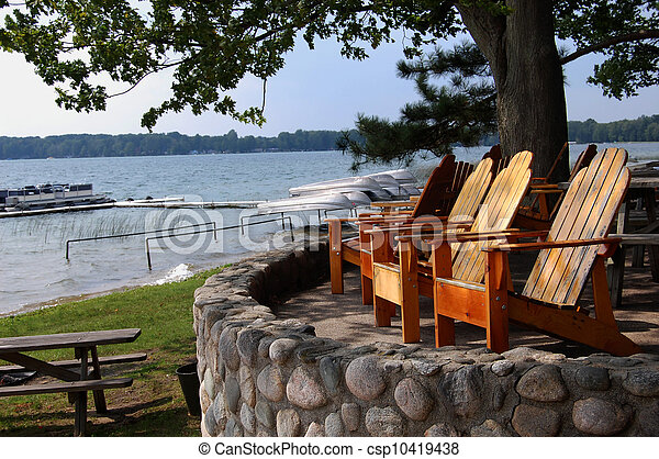 deck chairs overlooking lake with boats - csp10419438