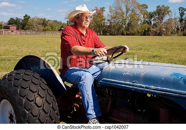 Cowboy on Tractor - csp1042007