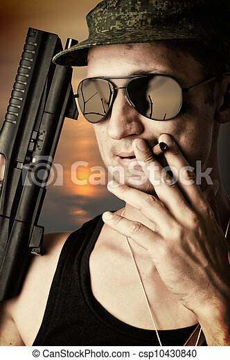 sexy military man wearing  sunglasses - csp10430840