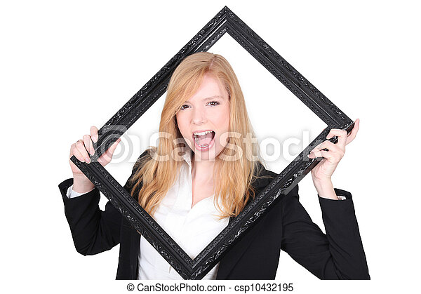 Young woman screaming with a frame in hands - csp10432195