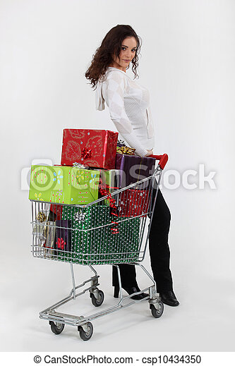 Woman with trolley full of Christmas presents - csp10434350