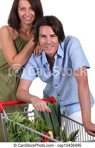 Couple with trolley full of vegetables - csp10436495