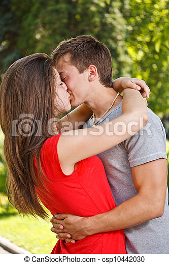 Couple kissing in park  - csp10442030