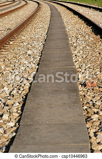 several rail tracks disappearing in the horizon