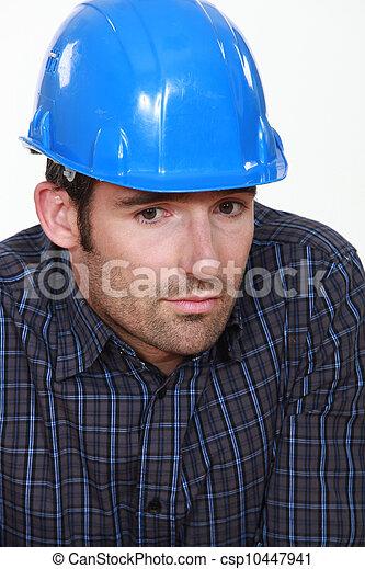 Portrait of tradesman lacking self-confidence - csp10447941