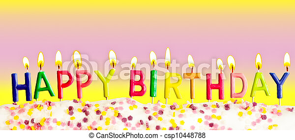 Happy birthday lit candles on colorful background - csp10448788