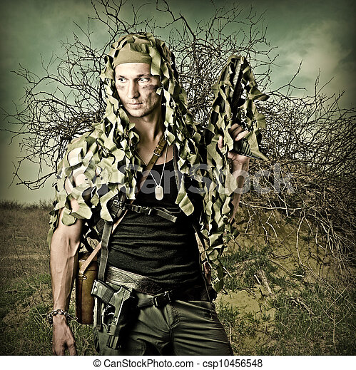 Military Camouflaged man with  automatic - csp10456548