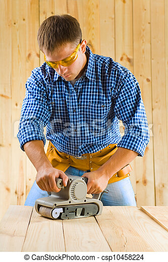 young men works with detail sander - csp10458224