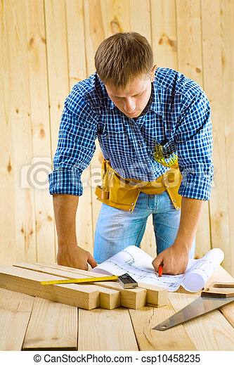 men looks on the blueprint - csp10458235