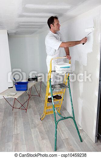 Photos de homme peinture mur csp10459238 recherchez des images des photographies et des - Droit locataire peinture murs ...