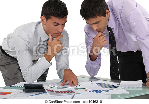 Two financial experts analyzing data - csp10463101