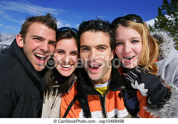 Portrait of friends on a skiing holiday together - csp10468498