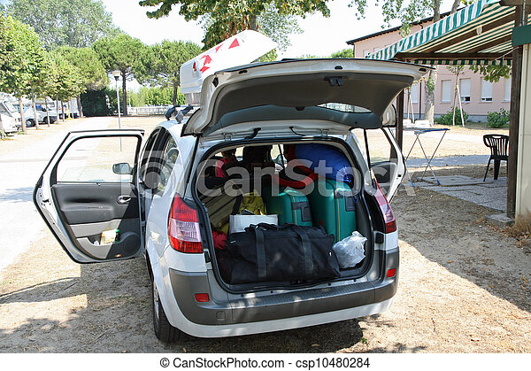family car of charge luggage ready for departure on holiday - csp10480284