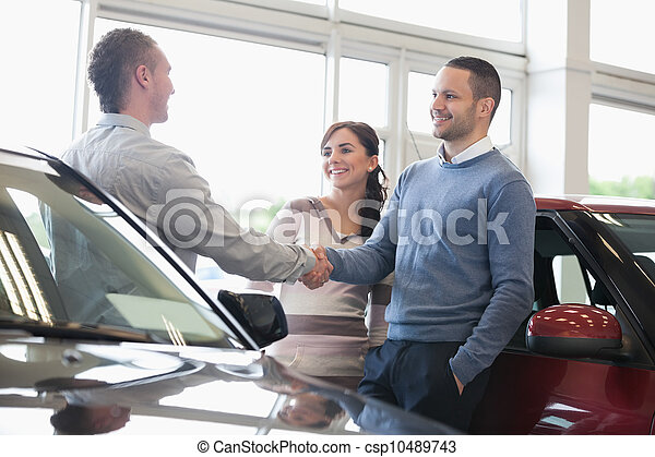 Man shaking a car dealer hand - csp10489743