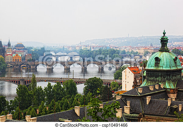 Prague, view of the Vltava River and bridges in a morning fog - csp10491466
