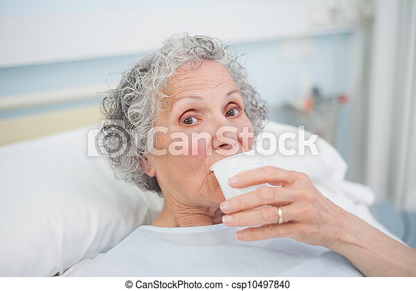 Elderly patient drinking - csp10497840