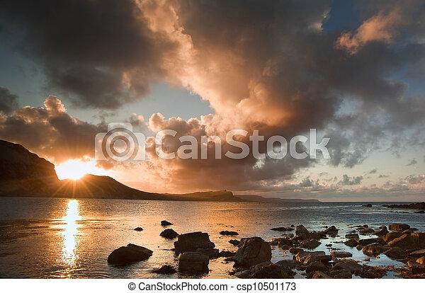 Sunrise ocean landscape Mupe Bay Jurassic Coast England - csp10501173