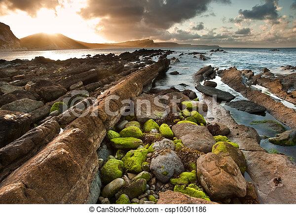 Sunrise ocean landscape Mupe Bay Jurassic Coast England - csp10501186