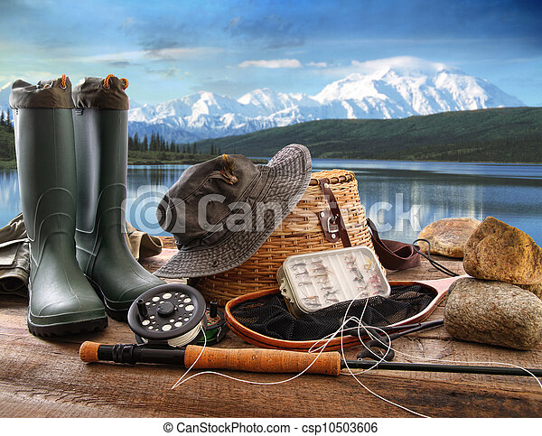 Fly fishing equipment on deck with view of a lake and mountains - csp10503606