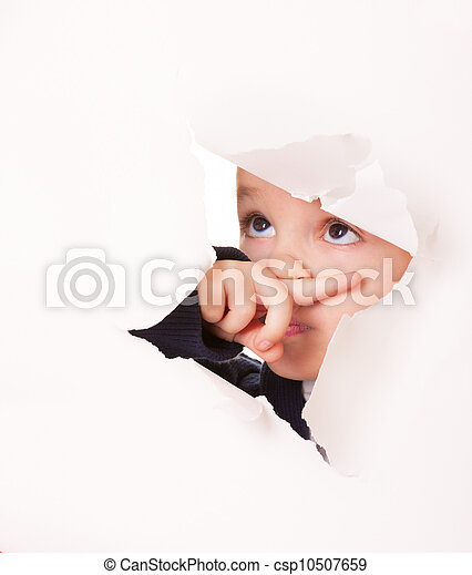 Guilty looking kid in a hole in white paper - csp10507659