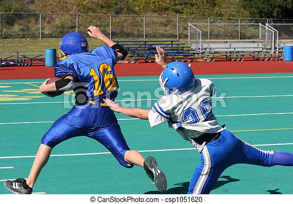 Youth Football Tackle - csp1051620