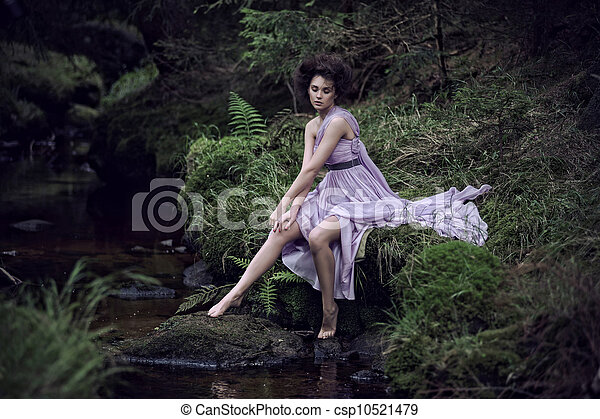Beauty woman in nature scenery - csp10521479