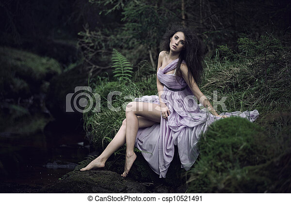 Nice woman in nature scenery - csp10521491