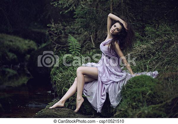Cute woman in nature scenery - csp10521510