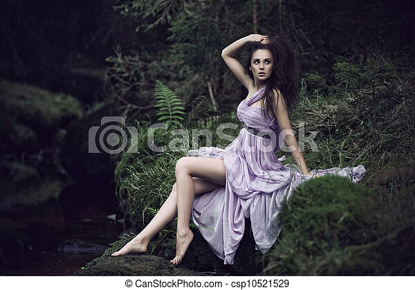 Sensual woman in nature scenery - csp10521529