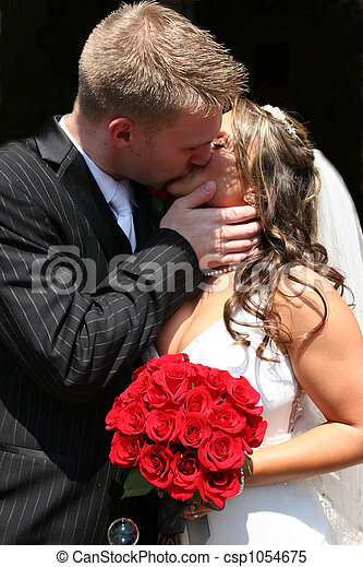 Bride and Groom Kissing - csp1054675