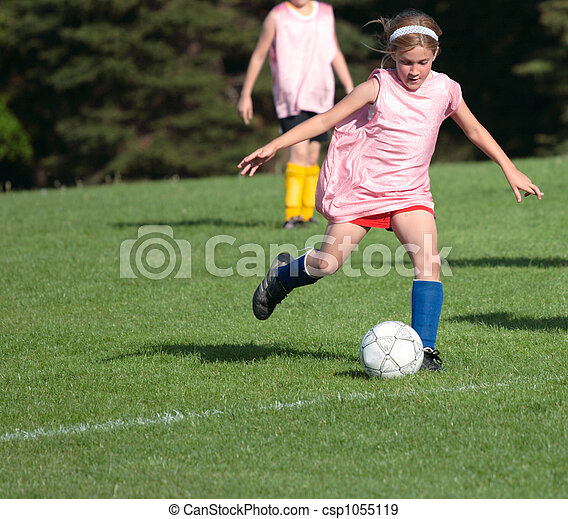 Soccer Player Kicking - csp1055119