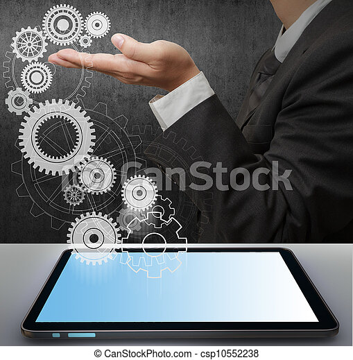 Business man show gear to success from touch screen computer - csp10552238