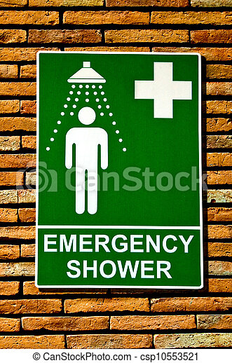 The Sign emergency safety shower on wall background  - csp10553521