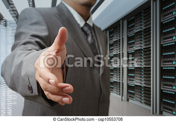 businessmen offer hand shake in a technology data center - csp10553708