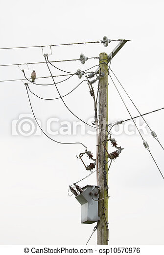 Power lines and transformer on pole - csp10570976