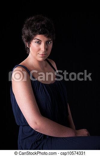 portrait of a beautiful young woman, on black, studio shot - csp10574331