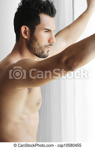 Man looking out window - csp10580455