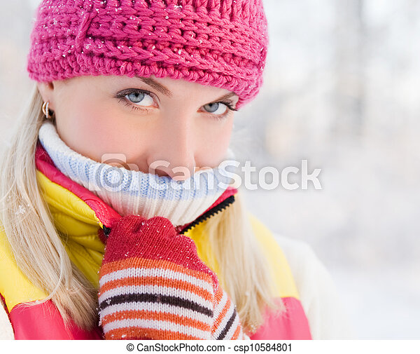 Frozen beautiful woman in winter clothing outdoors - csp10584801