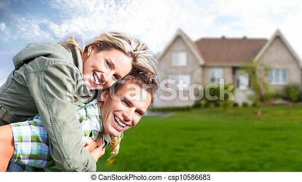 Happy family near new house. - csp10586683