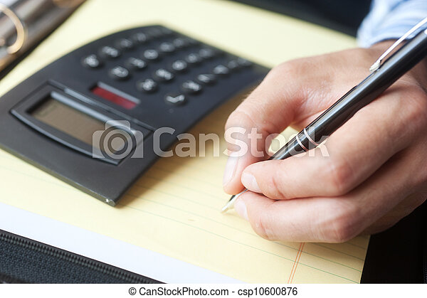 accounting with calculator and pen - csp10600876