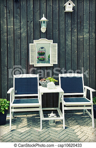 wooden chairs by home garden - csp10620433