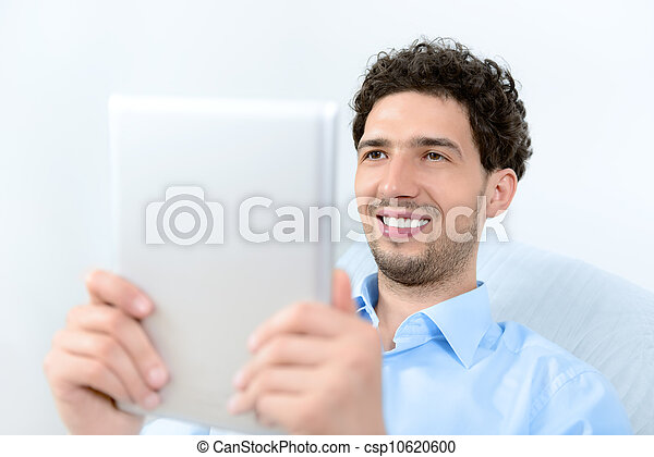 Man with digital tablet - csp10620600
