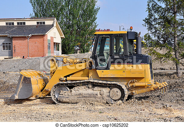 Yellow loader excavator on the construction place - csp10625202