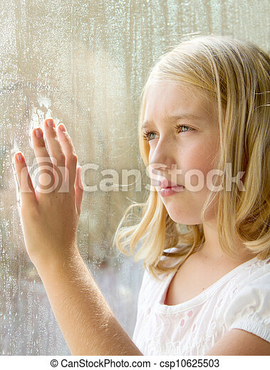 teen or child looking out a window - csp10625503