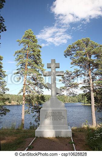 Orthodox cross on the bank of Lake Ladoga on the island of Valaam in Karelia - csp10628828