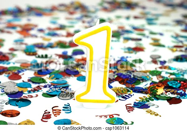 Number 1 celebration candle with confetti.