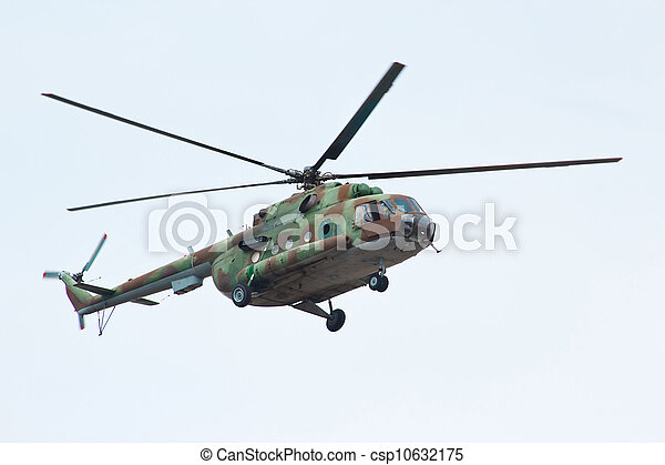 Russian military helicopter MI-8 in the cloudy sky - csp10632175
