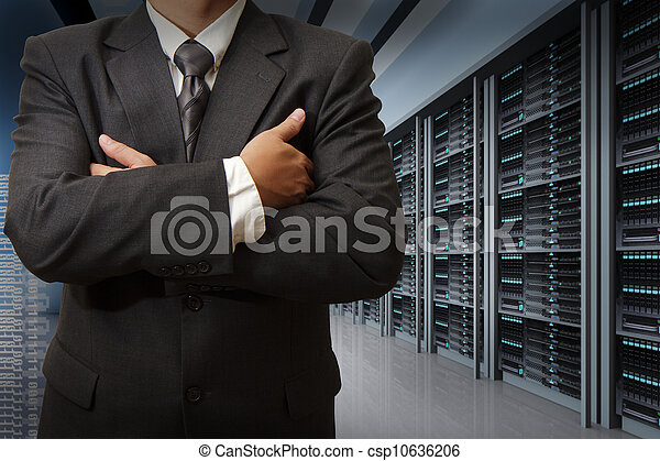 business man engineer in data center server room - csp10636206