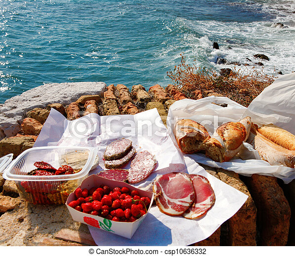 French food picnic outdoors near sea with market food. - csp10636332