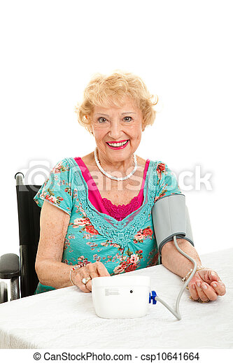 Woman Taking Her Own Blood Pressure - csp10641664